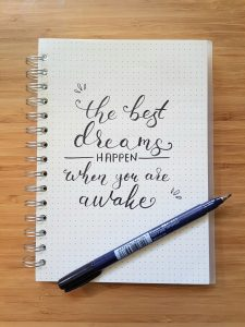 Notepad that says the best dreams happen when you are awake