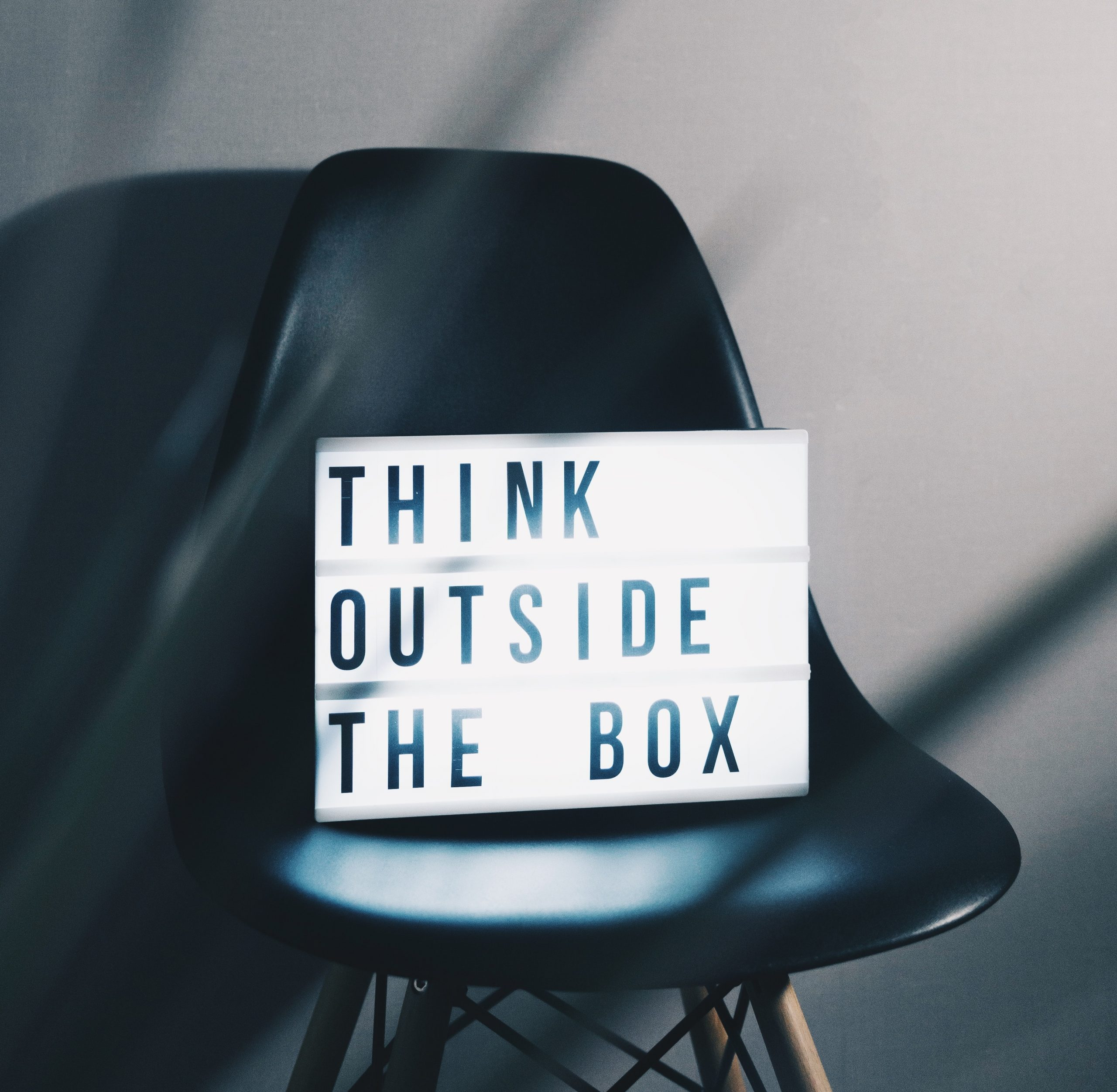 "21st Century Skills: Light box sitting on a chair with the words ""Think Outside the Box"""