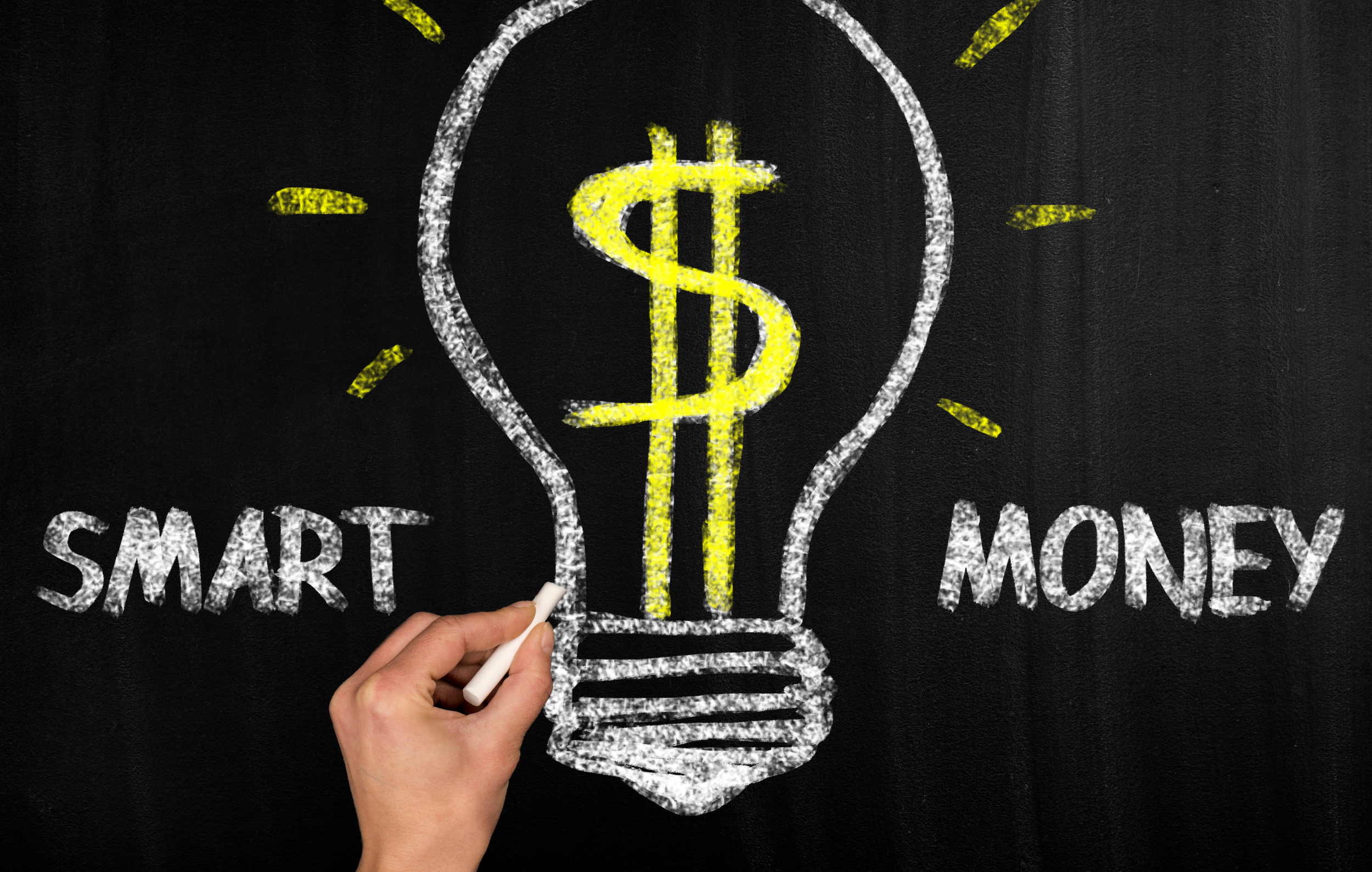 Money Smart Kids: blackboard picture of a lightbulb with a dollar sign in the middle and 'Smart Money' written
