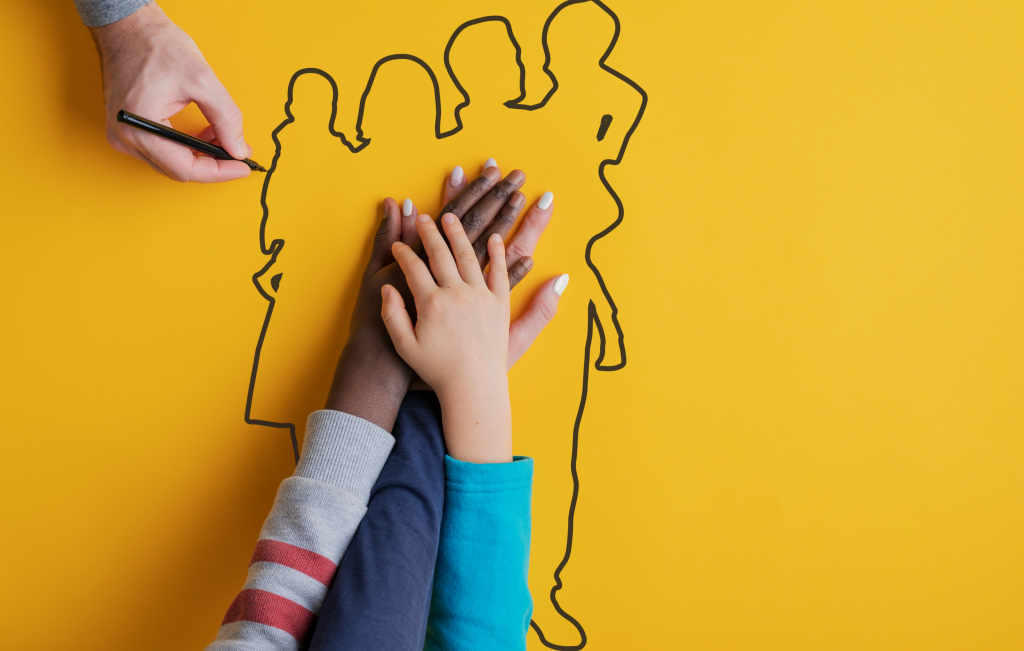 Family values - hands in the middle of an outline of a  family